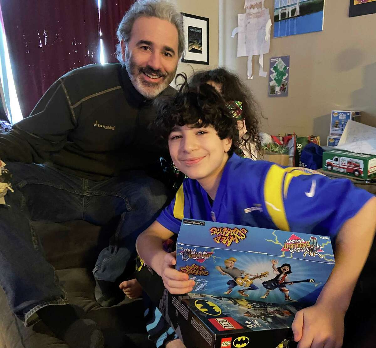 """Allie Tarantino celebrates his son, Cyrus, on his 12th birthday. His wife, Shira, calls Cyrus their """"inauguration baby,"""" since he was born on former President Barack Obama's first inauguration as president. Daughter Juniper Tarantino, 9, hides behind the two as they comemorate President Joe Biden's induction to the presidency."""