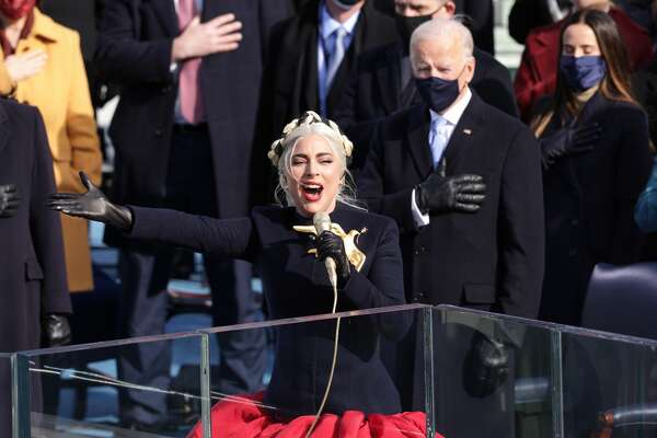 WASHINGTON, DC - JANUARY 20: Lady Gaga sings the National Anthem at the inauguration of U.S. President-elect Joe Biden on the West Front of the U.S. Capitol on January 20, 2021 in Washington, DC. During today's inauguration ceremony Joe Biden becomes the 46th president of the United States. (Photo by Alex Wong/Getty Images)
