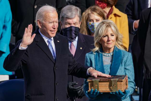 Joe Biden is sworn in as President during his inauguration on the West Front of the U.S. Capitol on January 20, 2021 in Washington, DC. During today's inauguration ceremony Joe Biden becomes the 46th president of the United States. Photo: Alex Wong/Getty Images / 2021 Getty Images