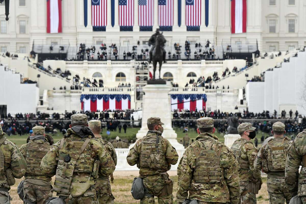 Members of the National Guard gather near the U.S. Capitol before the inauguration of U.S. President-elect Joe Biden and Vice President-elect Kamala Harris on January 20, 2021 in Washington, DC.