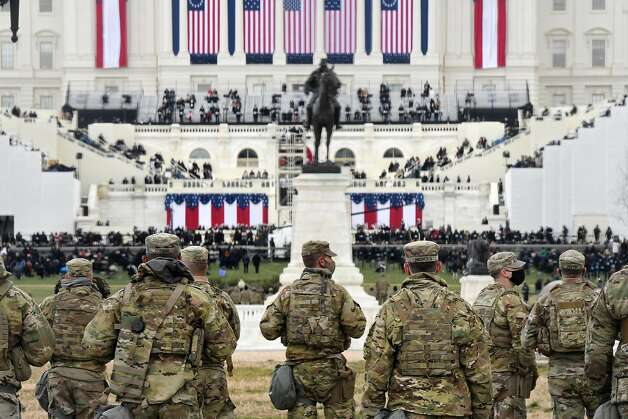 Members of the National Guard gather near the U.S. Capitol before the inauguration of U.S. President-elect Joe Biden and Vice President-elect Kamala Harris on January 20, 2021 in Washington, DC. Photo: Stephanie Keith, Getty Images