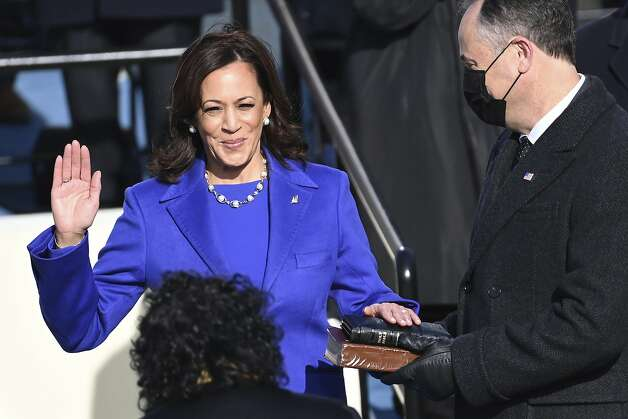 Kamala Harris is sworn in as vice president by Supreme Court Justice Sonia Sotomayor as her husband Doug Emhoff holds the Bible during the 59th Presidential Inauguration at the U.S. Capitol in Washington, Wednesday, Jan. 20, 2021.(Saul Loeb/Pool Photo via AP) Photo: Saul Loeb, Associated Press