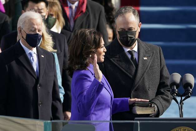 Kamala Harris is sworn in as Vice President by Supreme Court Justice Sonia Sotomayor as her husband Doug Emhoff holds the Bible during the 59th Presidential Inauguration at the U.S. Capitol in Washington, Wednesday, Jan. 20, 2021. Photo: Patrick Semansky, Associated Press