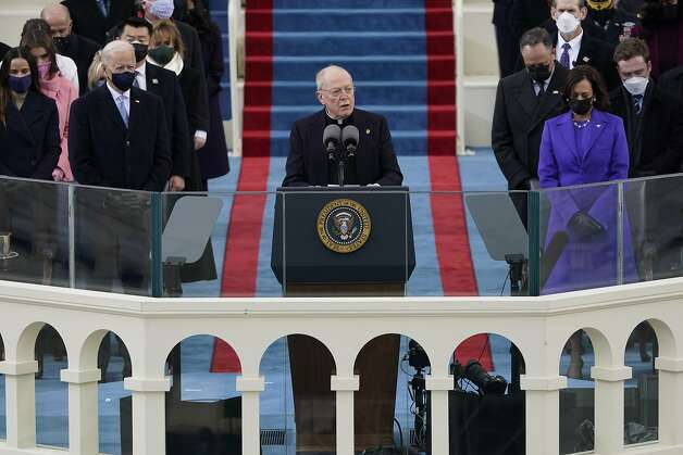 Father Leo O'Donovan delivers the invocation as President-elect Joe Biden, left, and Vice President-elect Kamala Harris look on during the 59th Presidential Inauguration at the U.S. Capitol in Washington, Wednesday, Jan. 20, 2021.(AP Photo/Patrick Semansky, Pool) Photo: Patrick Semansky, Associated Press