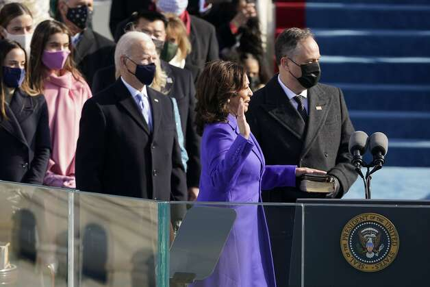 Kamala Harris is sworn in as vice president by Supreme Court Justice Sonia Sotomayor as her husband Doug Emhoff holds the Bible during the 59th Presidential Inauguration at the U.S. Capitol in Washington, Wednesday, Jan. 20, 2021. (AP Photo/Patrick Semansky, Pool) Photo: Patrick Semansky, Associated Press