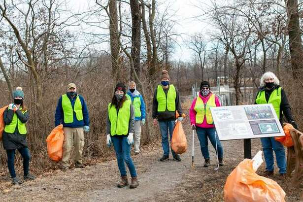 Volunteers pick up trash and remove invasive species from Arlington Wetlands Monday as part of the Dr. Martin Luther King Jr. Day of Service. The area is being readied for a prescribed prairie restoration burn later this winter. Volunteer hours spent at the site help Heartlands Conservancy fulfill a Community Challenge Grant from the Illinois Clean Energy Community Foundation.