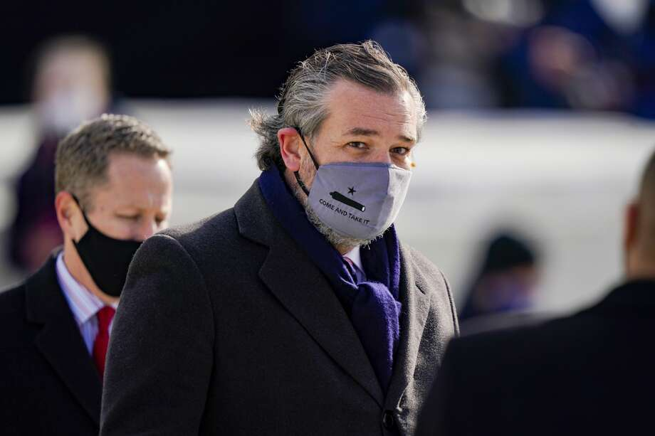 """Sen. Ted Cruz (C) (R-TX), wearing a face mask that reads """"Come and Take It"""", arrives to the inauguration of U.S. President-elect Joe Biden on the West Front of the U.S. Capitol on January 20, 2021 in Washington, DC. During today's inauguration ceremony Joe Biden becomes the 46th president of the United States. Photo: Drew Angerer/Getty Images / 2021 Getty Images"""