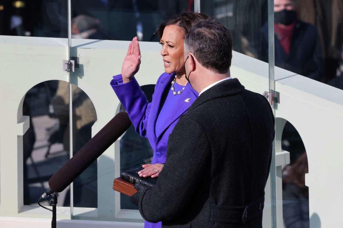 WASHINGTON, DC - JANUARY 20: Kamala Harris is sworn in as U.S. Vice President as her husband Doug Emhoff looks on at the inauguration of U.S. President-elect Joe Biden on the West Front of the U.S. Capitol on January 20, 2021 in Washington, DC. During today's inauguration ceremony Joe Biden becomes the 46th president of the United States. (Photo by Tasos Katopodis/Getty Images)