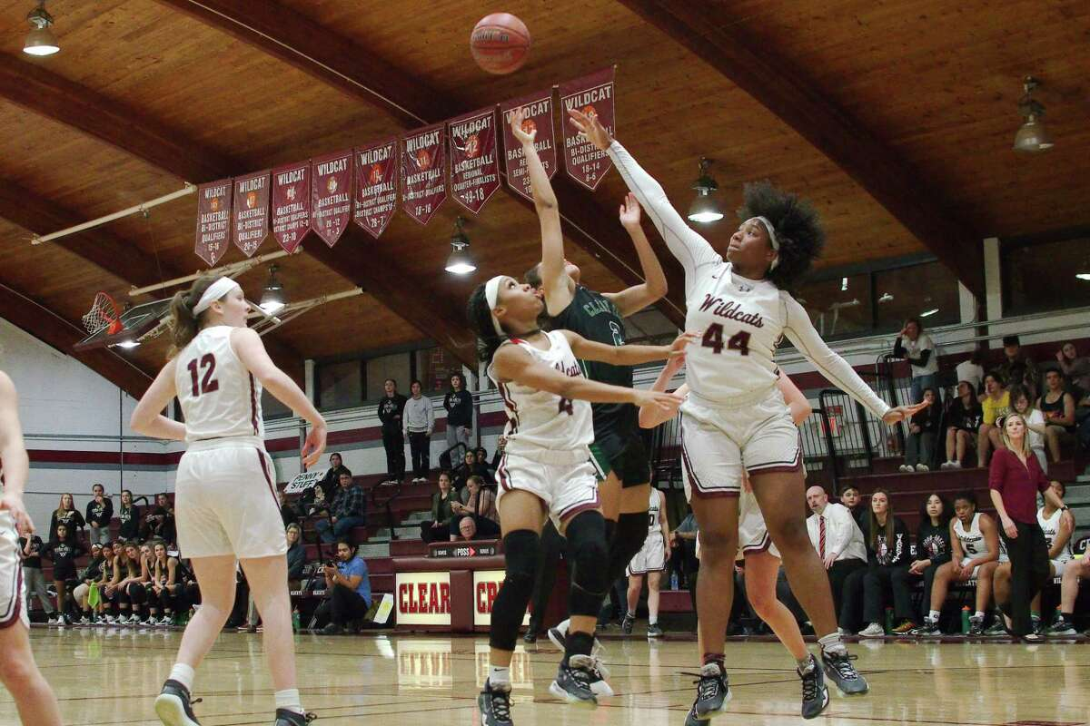 Clear Creek's Olivia Shaw (12), Kirsten Lockett-Bell (4) and Eliya Ellis (44) have been instrumental in the Lady Wildcats' recent surge in the District 24-6A basketball race.