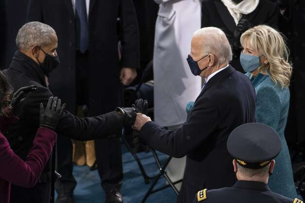 President-elect Joe Biden greets former President Barack Obama as he arrives at the West Front of the Capitol, Wednesday, Jan. 20, 2021, in Washington. Photo: Caroline Brehman / Pool / Associated Press