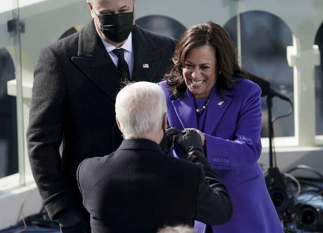 Vice President Kamala Harris bumps fists with President-elect Joe Biden after she was sworn in during the inauguration, Wednesday, Jan. 20, 2021, at the U.S. Capitol in Washington. Photo: Greg Nash, Associated Press
