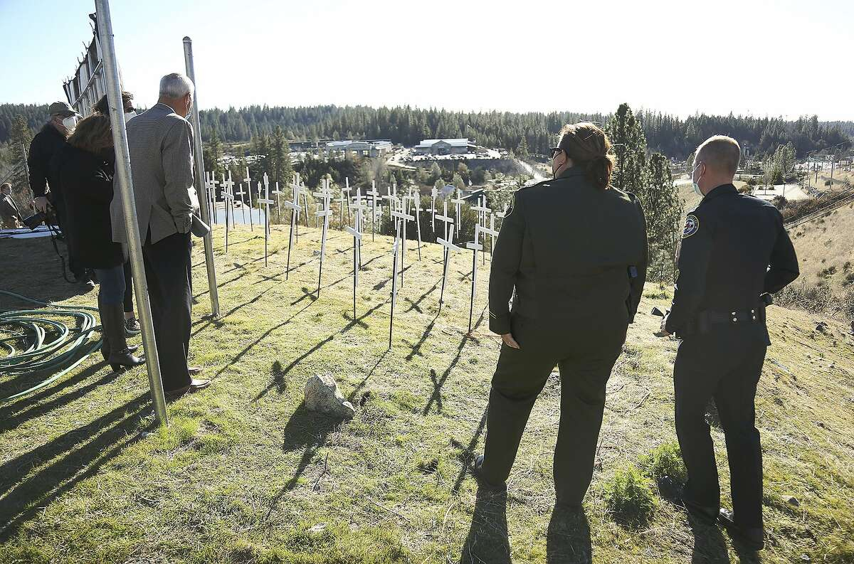 Nevada County Supervisor Dan Miller, Sheriff Moon, and Chief Alex Gammelgard were a few to pay their respects to those lives lost to the coronavirus in Nevada County Tuesday, Jan. 19, 2021 in Grass Valley, Calif. (Elias Funez/The Union via AP)