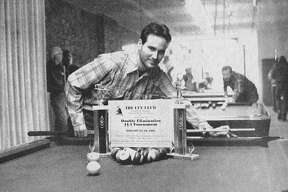 From the Jan. 21, 1981 issue of the Manistee News Advocate, the Cue Club's 14-1 Tournament will be held this Saturday, beginning at 2:30 p.m. Registrations will be accepted until 2 p.m. the day of tournament, according Russ Potts, owner of the club, shown above with the trophies that will be awarded this weekend. (Manistee County Historical Museum photo)