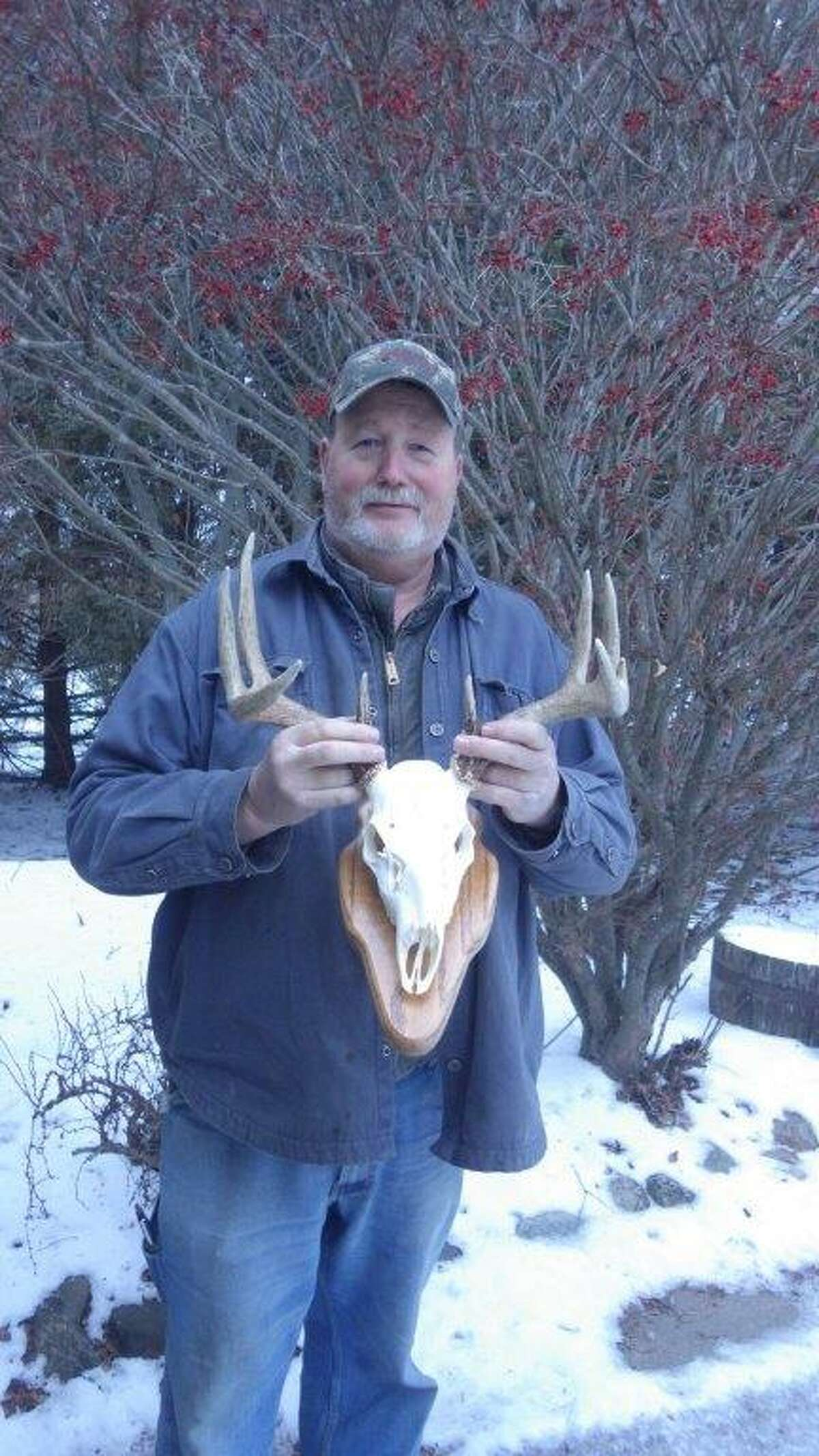 Ken Martin of Cass City holds the mount of his vampire buck.