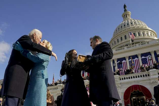 President Joe Biden and first lady Jill Biden, kiss as his son Hunter Biden and daughter Ashley Biden look on after being sworn-in during the 59th Presidential Inauguration at the U.S. Capitol in Washington, Wednesday, Jan. 20, 2021. Photo: Andrew Harnik, Associated Press