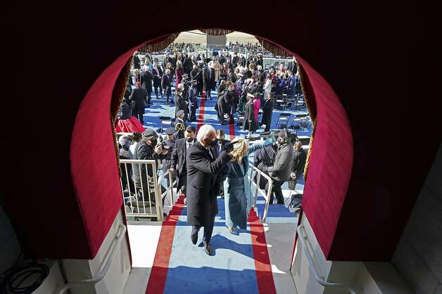 President Joe Biden and first lady Jill Biden gesture as they leave after his inauguration at the U.S. Capitol in Washington, Wednesday, Jan. 20, 2021. Photo: Chang W. Lee, Associated Press