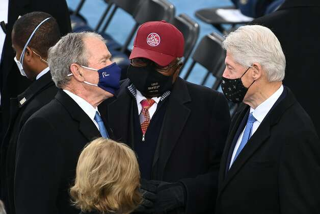 Former President George W Bush (left), Jym Clyburn from South Carolina and Former President Bill Clinton (right) speak ahead of the inauguration of Joe Biden as the 46th US President, on the West Front of the US Capitol in Washington, DC on January 20, 2021. Photo: Saul Loeb, POOL/AFP Via Getty Images