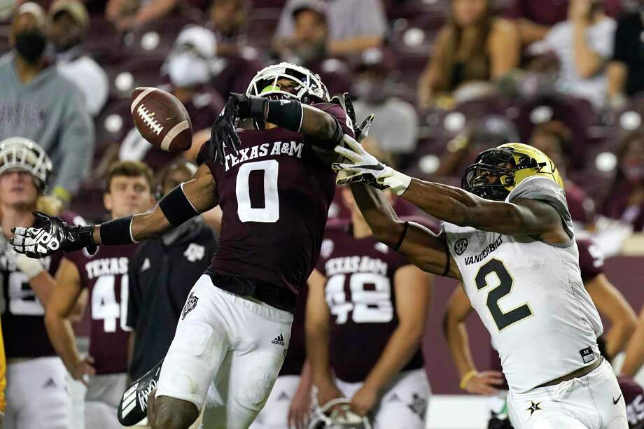 Texas A&M's Myles Jones (0) breaks up a pass intended for Vanderbilt's Amir Abdur-Rahman (2) during the second half of an NCAA college football game Saturday, Sept. 26, 2020, in College Station, Texas. Texas A&M won 17-12. (AP Photo/David J. Phillip) Photo: David J. Phillip, STF / Associated Press / Copyright 2020 The Associated Press. All rights reserved