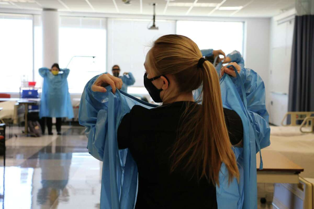 Nursing students at the University of Houston College of Nursing in Sugar Land went through a boot camp of sorts this week, learning how to properly put on personal protection equipment and take vital signs of patients.