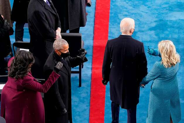 Former President Barrack Obama and Michelle Obama, greeting President-elect Joe Biden and Jill Biden during the 59th Presidential Inauguration at the US Capitol in Washington, January 20, 2021. Photo: Susan Walsh, POOL/AFP Via Getty Images