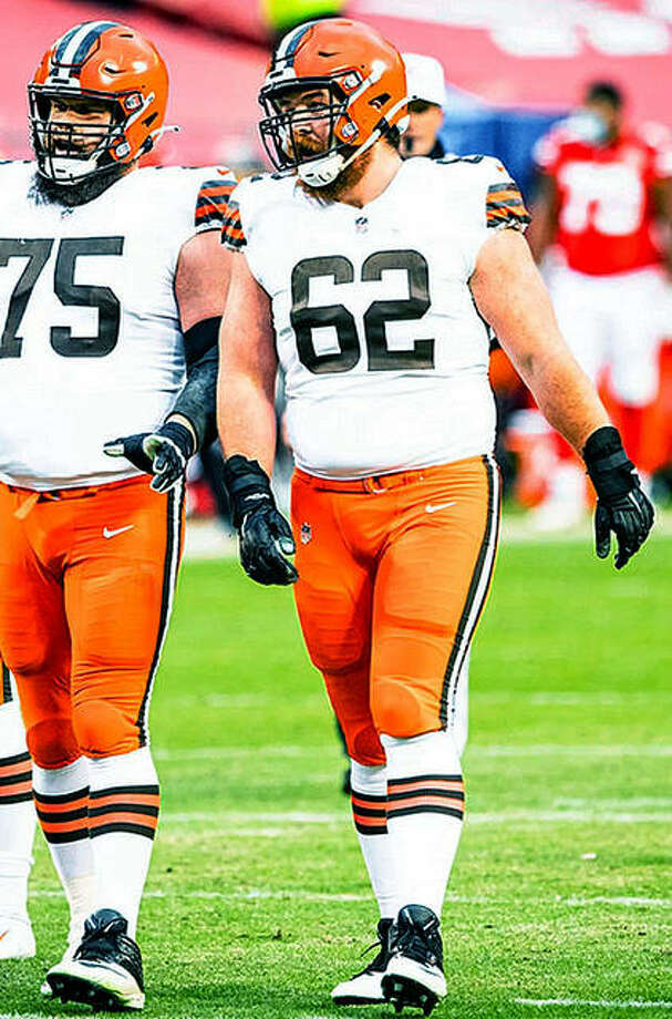 Cleveland Browns guard Blake Hance, a graduate of Jacksonville High School and Northwestern University, talks with Browns teammate Joel Bitonio during Sunday's AFC playoff game against the Chiefs in Kansas City. Photo: Matt Starkey | Cleveland Browns Photo