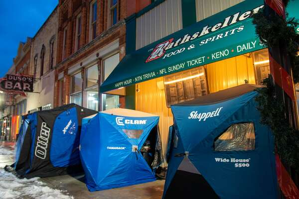 Across the Great Lakes Bay Region and beyond, residents are repurposing pop-up ice fishing shelters to keep themselves warm outside in Michigan winter as they enjoy a meal at their favorite local eatery. (Facebook photo/Damien Perez, Operation Shantyville - Support Local Businesses)