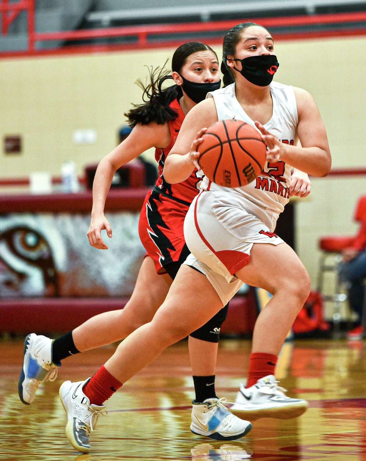 Martin High School Jari Garcia moves the ball down the court during a game against Rio Grande City High School Rattlers, Tuesday, Jan. 19, 2021, at Martin High School.