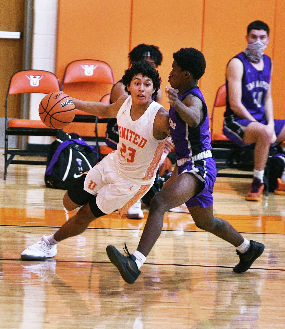 Carlos Castro drives to the basket for the United Longhorns as they played San Marcos Saturday, November 14, 2020 at the UHS Ninth Grade Campus gym.