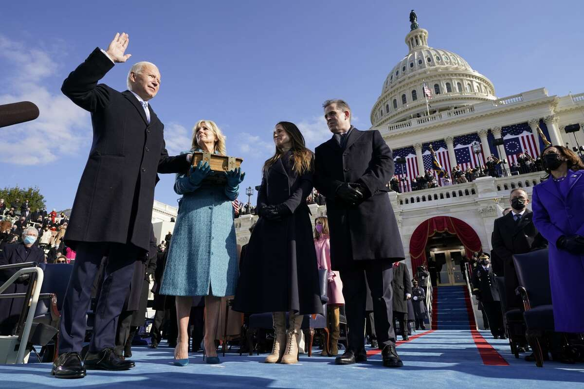 Joe Biden is sworn in as the 46th president of the United States by Chief Justice John Roberts as Jill Biden holds the Bible during the 59th Presidential Inauguration at the U.S. Capitol in Washington, Wednesday, Jan. 20, 2021. (AP Photo/Andrew Harnik, Pool)