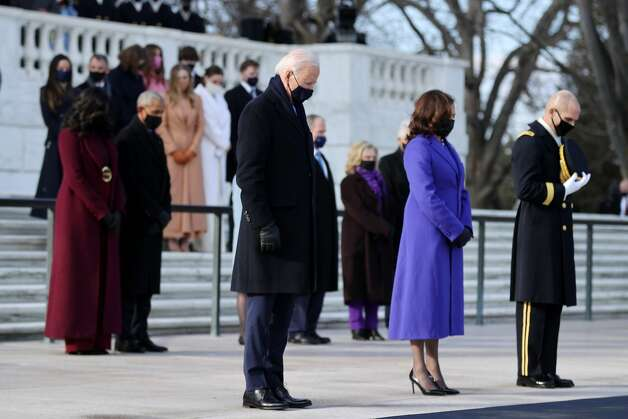 President Joe Biden and Vice President Kamala Harris attend a wreath-laying ceremony at Arlington National Cemetery's Tomb of the Unknown Soldier after the 59th Presidential Inauguration ceremony at the U.S. Capitol, as Former President Barack Obama, Michelle Obama, and former President George W. Bush and Laura Bush, and former President Bill Clinton and former Secretary of State Hillary Clinton look on, January 20, 2021 in Arlington, Virginia. During today's inauguration ceremony Joe Biden becomes the 46th president of the United States. Photo: Chip Somodevilla/Getty Images / 2021 Getty Images