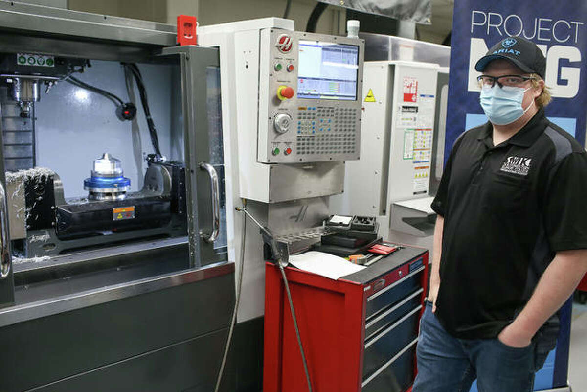 Southwest Illinois College's Connor Braasch of Troy uses a MasterCam 2021 to design a machine part for the Department of Defense Advanced Manufacturing contest.