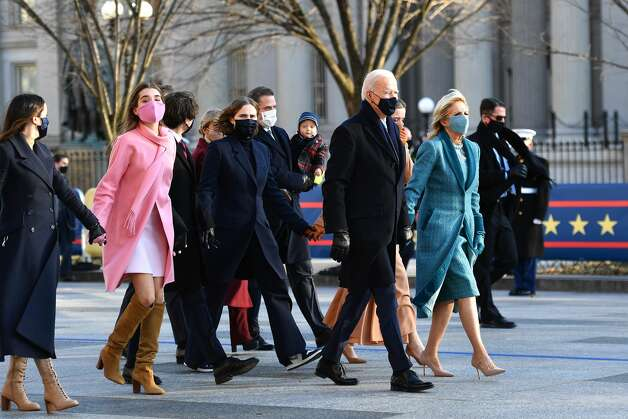 President Joe Biden, First Lady Dr. Jill Biden and family walk the abbreviated parade route after Biden's inauguration on January 20, 2021 in Washington, DC. Biden became the 46th president of the United States earlier today during the ceremony at the U.S. Capitol. Photo: Mark Makela/Getty Images / 2021 Getty Images
