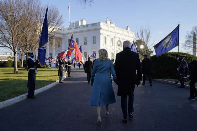 President Joe Biden walks with first lady Jill Biden to the White House during Inauguration Day ceremonies, Wednesday, Jan. 20, 2021, in Washington. Photo: Evan Vucci/AP / Copyright 2021 The Associated Press. All rights reserved