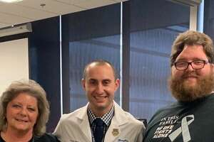 Teri Collver, left, Adam Robin, M.D. and Joseph Greene. (Photo provided/Henry Ford Health System)