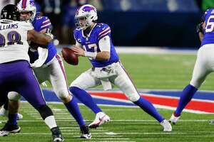 Buffalo Bills quarterback Josh Allen (17) carries the ball during the first half of an NFL football game against the Baltimore Ravens in Orchard park, N.Y., Saturday Jan. 16, 2021. The game attracted a season-high average audience of about 27 million for Stamford-based NBC Sports.