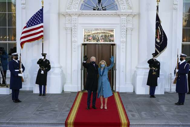 President Joe Biden and first lady Jill Biden wave as they arrive at the North Portico of the White House, Wednesday, Jan. 20, 2021, in Washington. Photo: Alex Brandon/AP / Copyright 2021 The Associated Press. All rights reserved.
