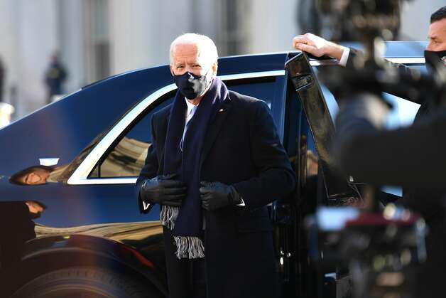President Joe Biden prepares to walk the abbreviated parade route after Biden's inauguration on January 20, 2021 in Washington, DC. Biden became the 46th president of the United States earlier today during the ceremony at the U.S. Capitol. Photo: Mark Makela/Getty Images / 2021 Getty Images