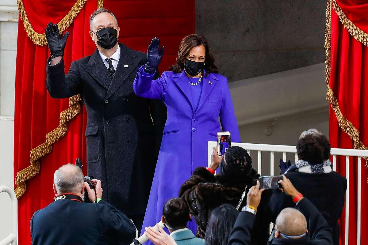 Second gentleman Doug Emhoff and Vice President Kamala Harris make their entrance to the inauguration.