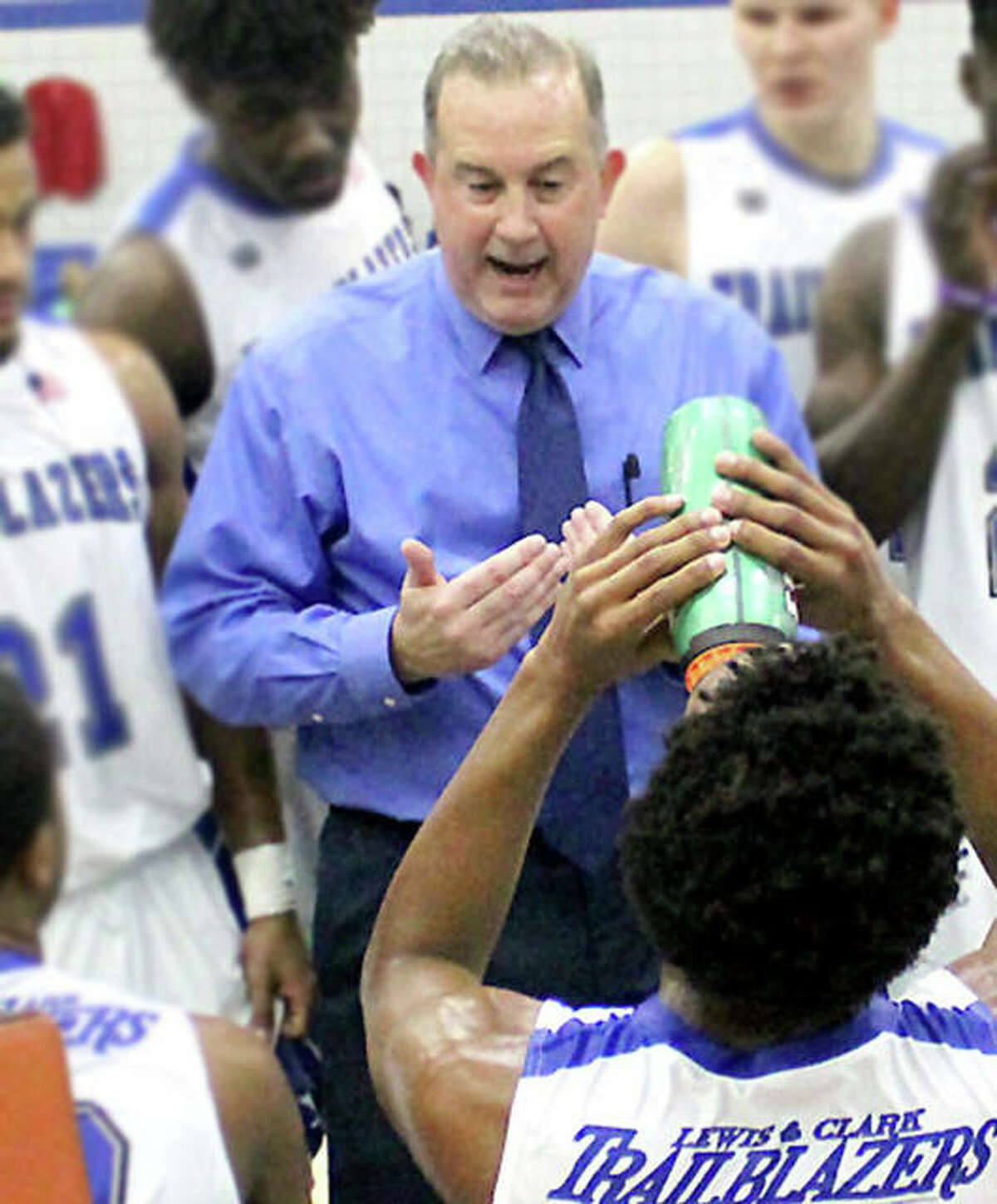 LCCC men's basketball coach Doug Stotler speaks to his team during a timeout against Wabash Valley.