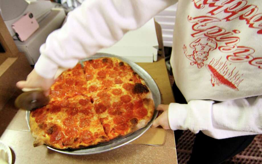 "During COVID-19 restaurant shutdowns, Zuppardi's Apizza in West Haven and Derby offered ""pizza at home"" kits with dough, cheese, sauce and toppings.