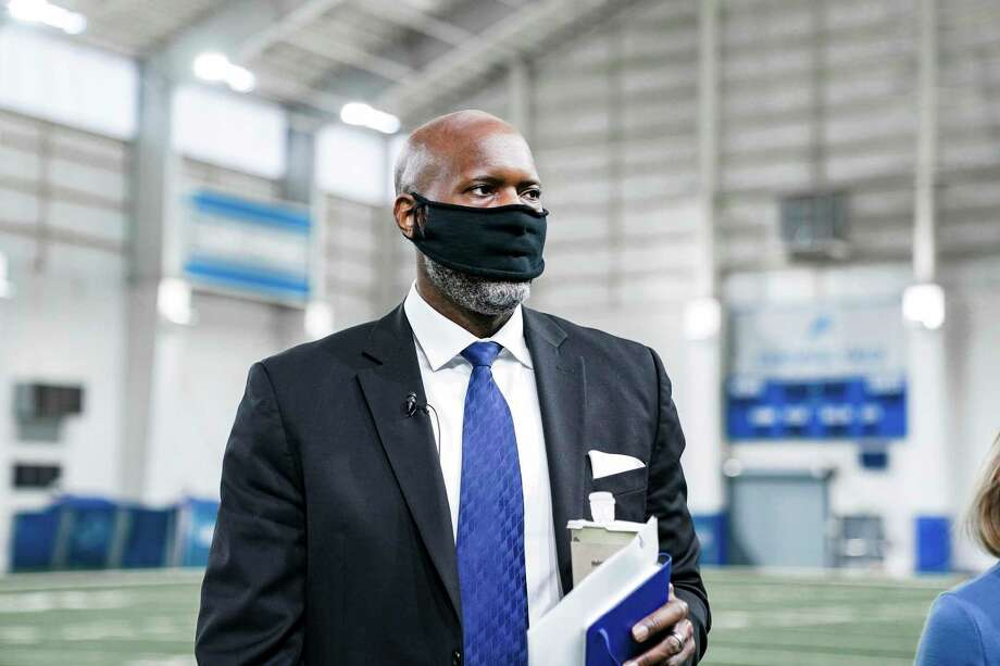 In a photo provided by the Detroit Lions, Detroit Lions general manager Brad Holmes walks around in the indoor practice field at the NFL football team's facility Tuesday, Jan. 19, 2021 in Allen Park, Mich. (Detroit Lions via AP). / Detroit Lions