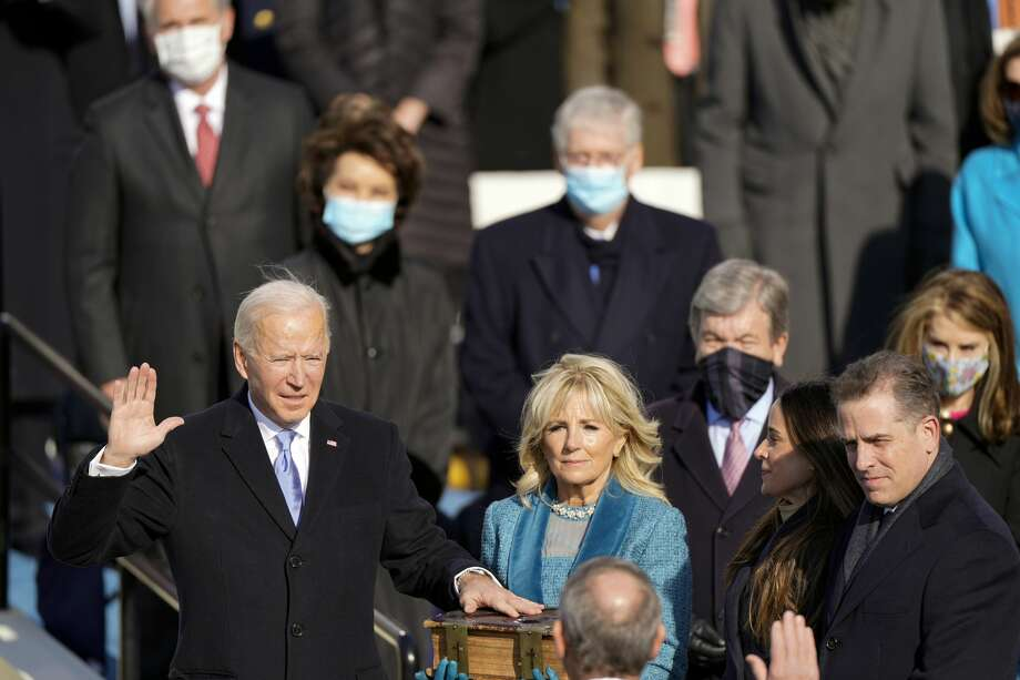 Joe Biden is sworn in as the 46th president of the United States by Chief Justice John Roberts as Jill Biden holds the Bible during the 59th Presidential Inauguration at the U.S. Capitol in Washington, Wednesday, Jan. 20, 2021, and children Ashley and Hunter watch. Photo: Andrew Harnik/AP / Copyright 2021 The Associated Press. All rights reserved