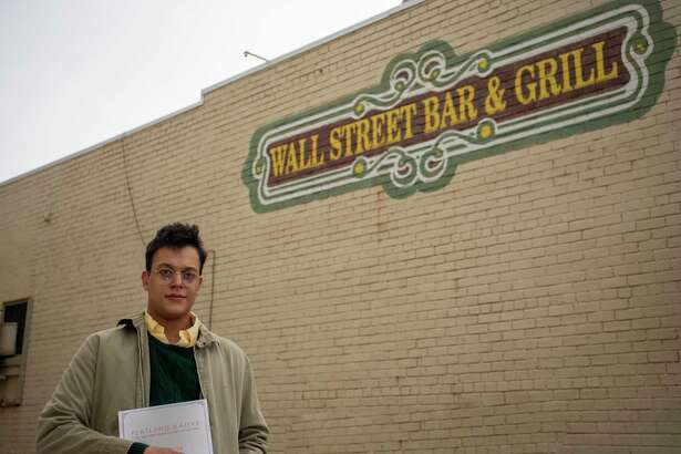 J.M. Smith poses for a portrait by a mural Tuesday, Jan. 19, 2021 at Wall Street Bar and Grill. Jacy Lewis/Reporter-Telegram