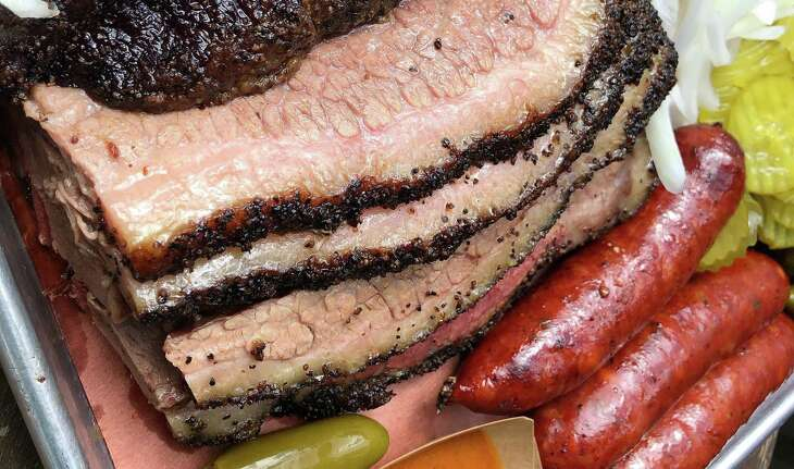 Slices of brisket, sausage links and more from Pinkerton's Barbecue, which is set to open in San Antonio downtown in February.
