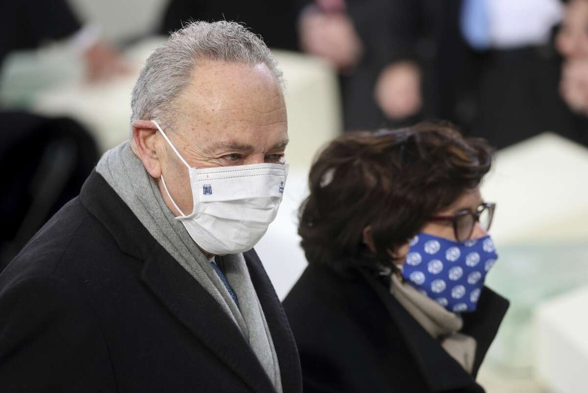 Sen. Chuck Schumer, D-N.Y., arrives with his wife Iris Weinshall before President-elect Joe Biden's inauguration, Wednesday, Jan. 20, 2021, at the U.S. Capitol in Washington. (Jonathan Ernst/Pool Photo via AP)