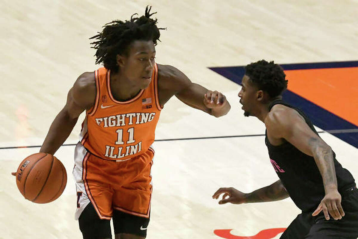 Illinois guard Ayo Dosunmu (11) drives past Penn State guard Jamari Wheeler during the first half of an NCAA college basketball game Tuesday, Jan. 19, 2021, in Champaign, Ill.