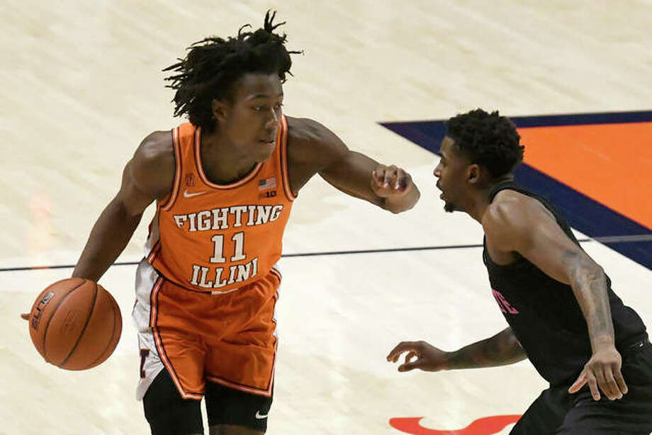 Illinois guard Ayo Dosunmu (11) drives past Penn State guard Jamari Wheeler during the first half of an NCAA college basketball game Tuesday, Jan. 19, 2021, in Champaign, Ill. Photo: Associated Press