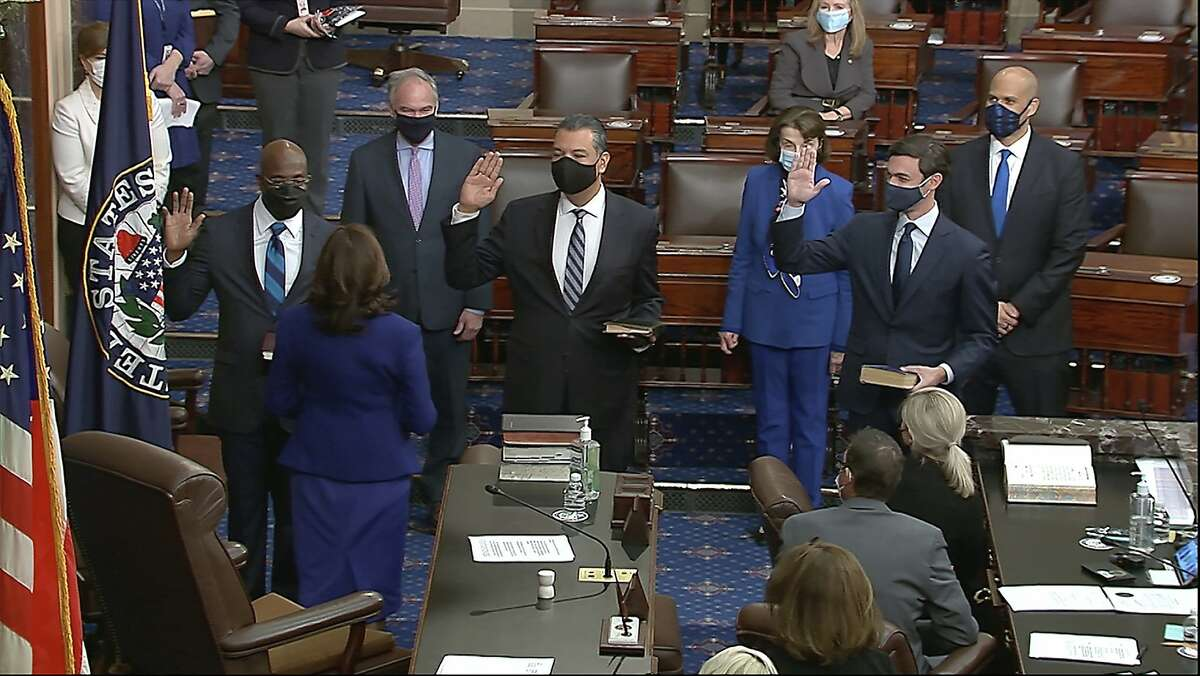 In this image from video, Vice President Kamala Harris swears in Sen. Raphael Warnock, D-Ga., Sen. Alex Padilla, D-Calif., and Sen. Jon Ossoff, D-Ga., on the floor of the Senate Wednesday, Jan. 6, 2021, on Capitol Hill in Washington. Padilla was appointed to replace Harris as one of California's Senators upon her election as Vice-president of the United States.