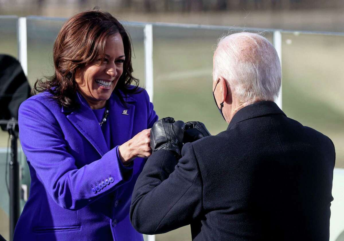 Kamala Harris (left) bumps fists with US President-elect Joe Biden (right) after being sworn in as the 49th US Vice President on January 20, 2021, at the US Capitol in Washington, DC.