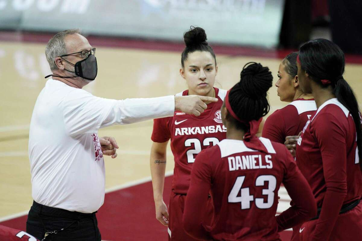 Arkansas head coach Mike Neighbors talks with players before an NCAA college basketball game against South Carolina Monday, Jan. 18, 2021, in Columbia, S.C. (AP Photo/Sean Rayford)